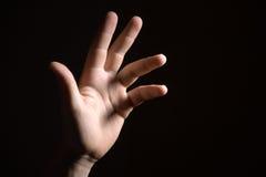 Hand. Man hand in the dark Stock Image