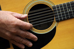 Hand and 12-string guitar Royalty Free Stock Photography