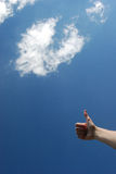Hand 17. Hand over sky and clouds Royalty Free Stock Images