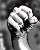 Hand. Clenched fist, a symbol of courage and strength of power and freedom Royalty Free Stock Image