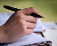 Hand. Closeup of a hand with ball pen and writing pad Royalty Free Stock Photo