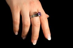 Hand 4. Female hand isolated on black, tungsten lighting used Royalty Free Stock Images