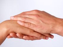 Hand. S of two women holding each other Stock Photo