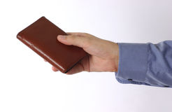 Hand. Holding a wallet royalty free stock photo