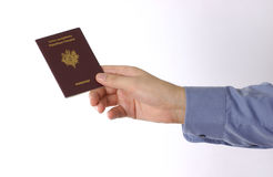 Hand. Holding a passport royalty free stock photography