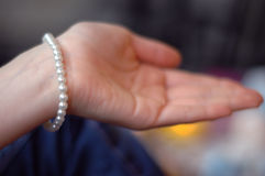 Hand. With pearly bracelet Royalty Free Stock Photos