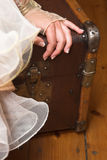 Hand. Bride sitting on an old suitcase just a hand visible royalty free stock photo