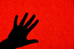 Hand. A hand over red background Stock Photo