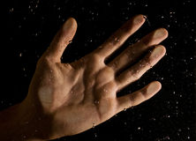 Hand. Male hand behind wet window Royalty Free Stock Photo