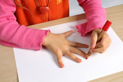 Hand. Left-handed girl make picture Stock Photo