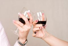 Hand. In wineglass with Beauty nail Royalty Free Stock Image