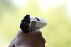 Hand with a 9mm pistol. Pistol ready to fire the target Royalty Free Stock Photography