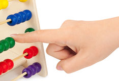 Hand and abacus Royalty Free Stock Images