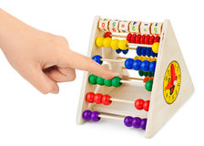Hand and abacus Stock Images