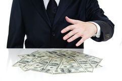 Hand above the money Stock Photos