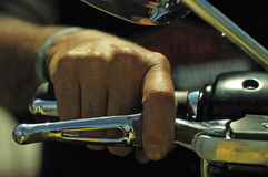 Hand on the acceleration of motor bike Stock Image