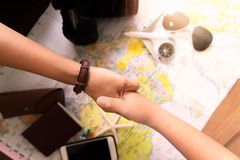 Hand with accessories for travel royalty free stock image
