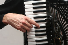 Hand on the accordion maual. Detail Royalty Free Stock Photo