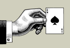 Hand with the ace of Spades playing card. Vintage engraving styl Stock Photos