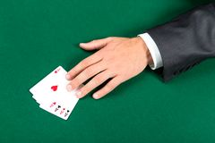 Hand with aces on the table Stock Image