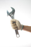 Hand and adjustable wrench Royalty Free Stock Photography