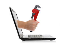 Hand with adjustable wrench. Comes from laptop screen on the white background stock photography