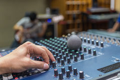 Hand adjusting audio mixer Stock Photography