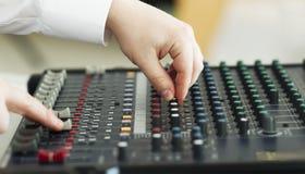 Hand adjusting audio mixer. Audio mixer music dj sound Stock Images