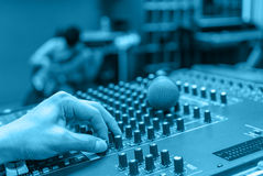 Hand adjusting audio mixer music and sound Stock Photography