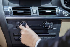 Hand adjusting the car button Royalty Free Stock Photos