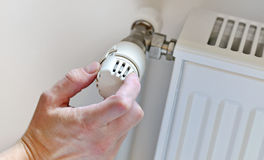 Hand Adjusting Heater Thermostat Royalty Free Stock Image