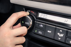 Hand adjusting the internal temperature of the car Royalty Free Stock Photos