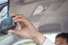 Hand adjusting rear view mirror Stock Images