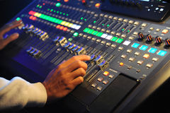 Hand adjusting sound mixer Royalty Free Stock Photos