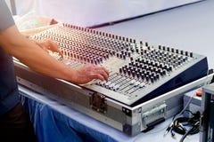 Hand adjusting sound mixer Stock Image