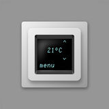 Hand adjusting thermostat. Hand adjusting home thermostat with digital display Stock Photo