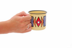 Hand with African coffee cup Royalty Free Stock Photos