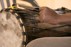 Hand of african man playing traditional instruments. Close up Royalty Free Stock Images