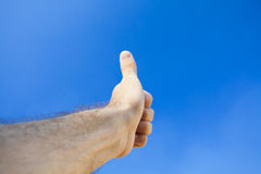 Hand against the sky Stock Photography