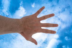 Hand against sky Stock Photography
