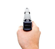 Hand aiming a modern automatic handgun Royalty Free Stock Photos