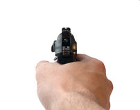 Hand with aiming pistol. Hand holding a black gun Royalty Free Stock Image
