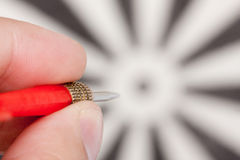 Hand aiming to target. By red dart Royalty Free Stock Photography