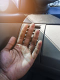 Hand on air conditioner vents car Stock Photos