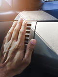 Hand on air conditioner vents car Royalty Free Stock Image