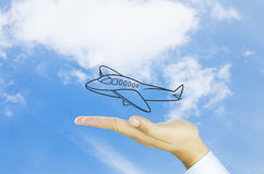 Hand and air plane Stock Images