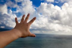 Hand in the air and touch cloud Stock Photography