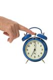 Hand and alarm clock Stock Photos