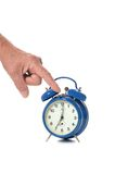 Hand and alarm clock Stock Photo