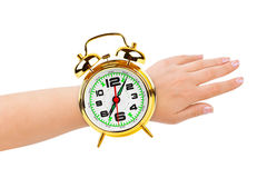 Hand and alarm clock like a watch Stock Photography